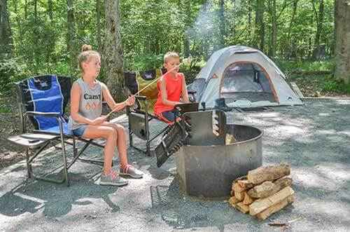 Kids roasting marshmallows by campfire at Pohick Bay Campgrounds