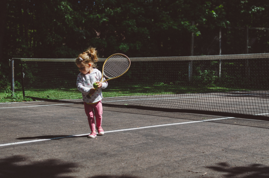 Child Playing Tennis at Wilderness Presidential Resort