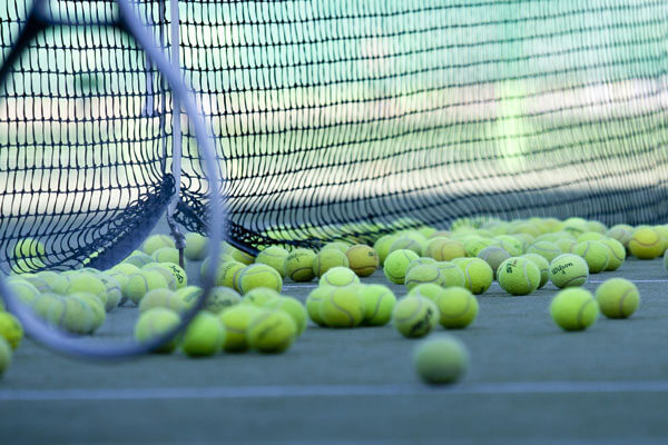 Tennis balls and court stock image