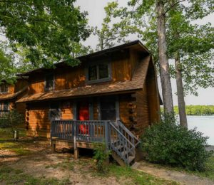 front view of log cabin on lake in fredericksburg virginia