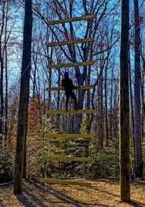 User on the Goliath Ladder at Wilderness Presidential Resort Adventure Park