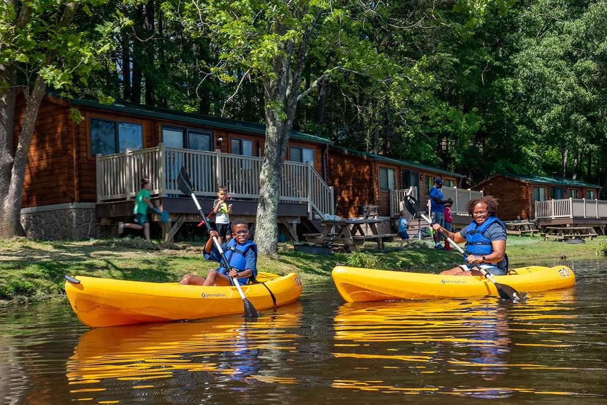 cabin and kayaks